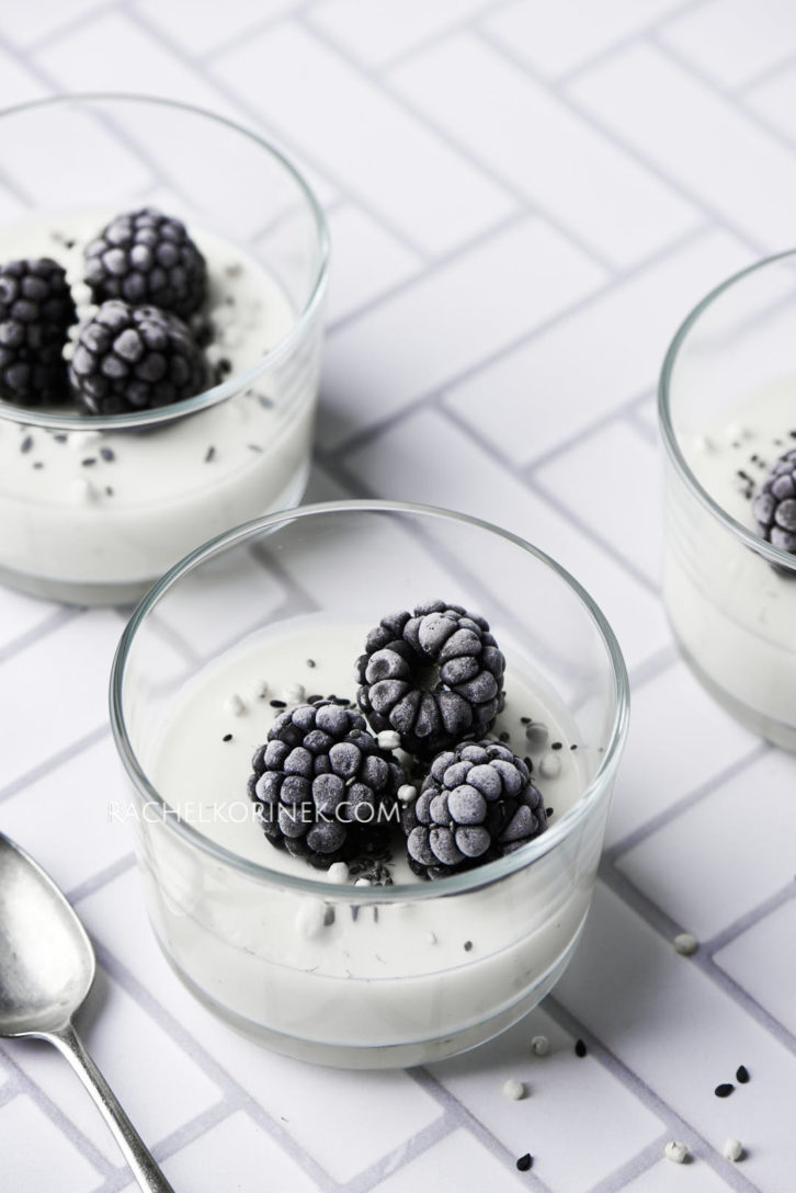 White chocolate panna cotta with frozen blackberries on top. There isn't any colour to this photo so it appears black and white even thought it's real food!