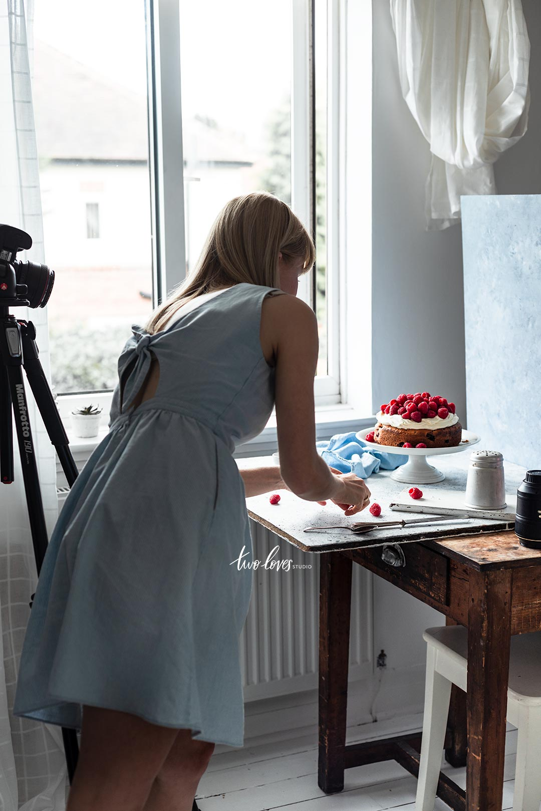 Bea working on a cake set up behind the hind the scenes shot.