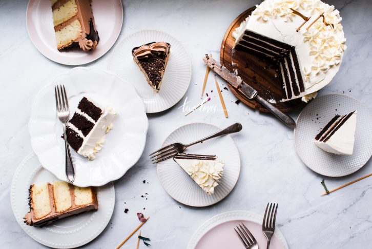 Cake slices in a assortment of plates.