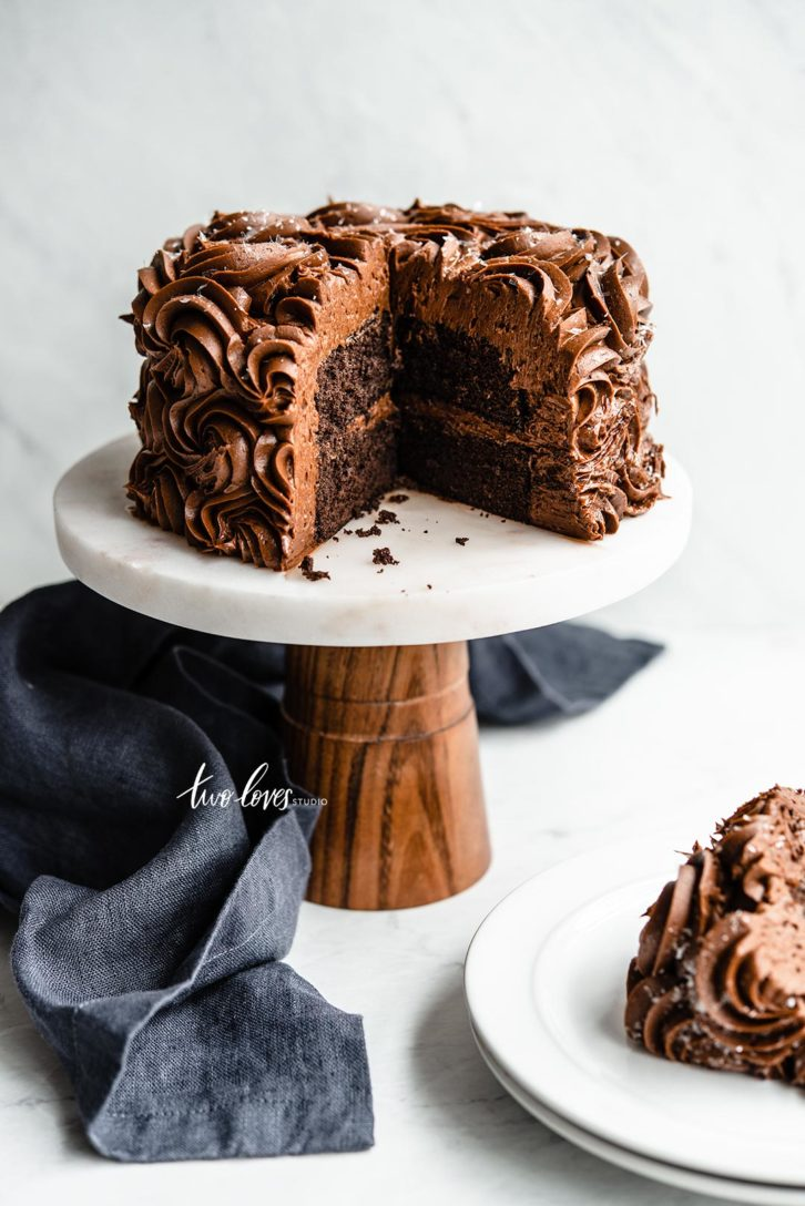 Two cakes on top of a cake stand with a slice cut out. Examples of lens distortion. 60mm lens.