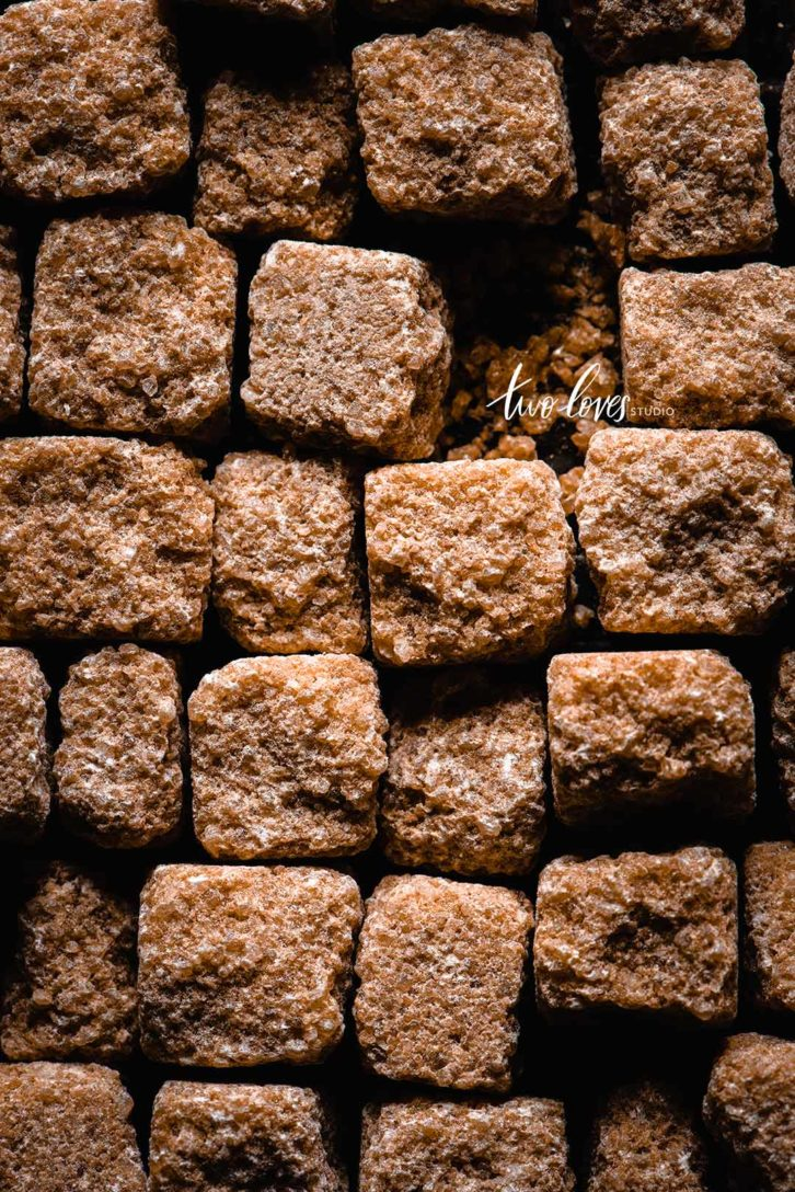 Close up shot of brown raw sugar cubes