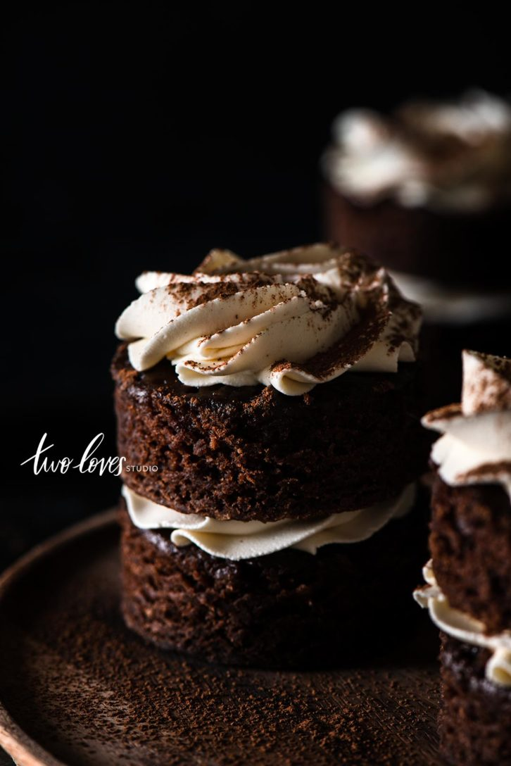 Small black cakes with white frosting