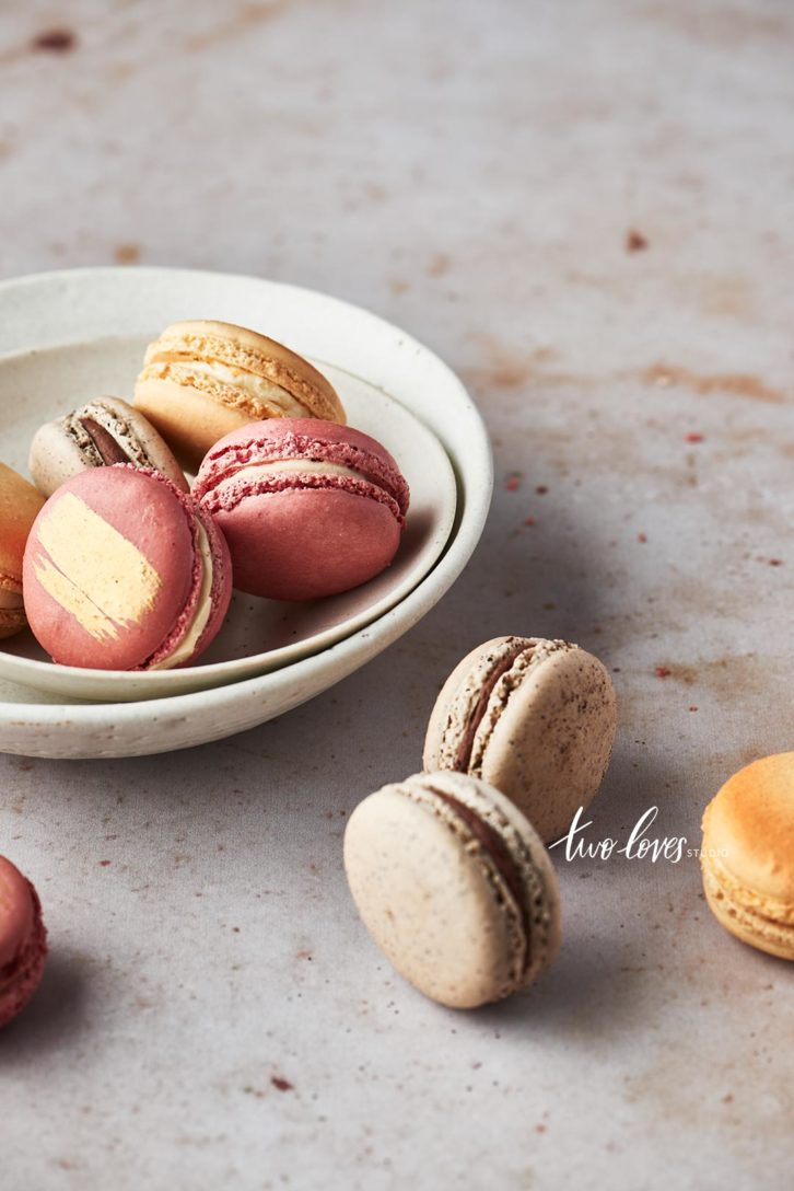 Soft coloured macaroons in a white bowl