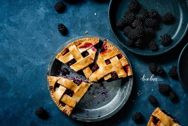 Blackberry pie cut into pieces