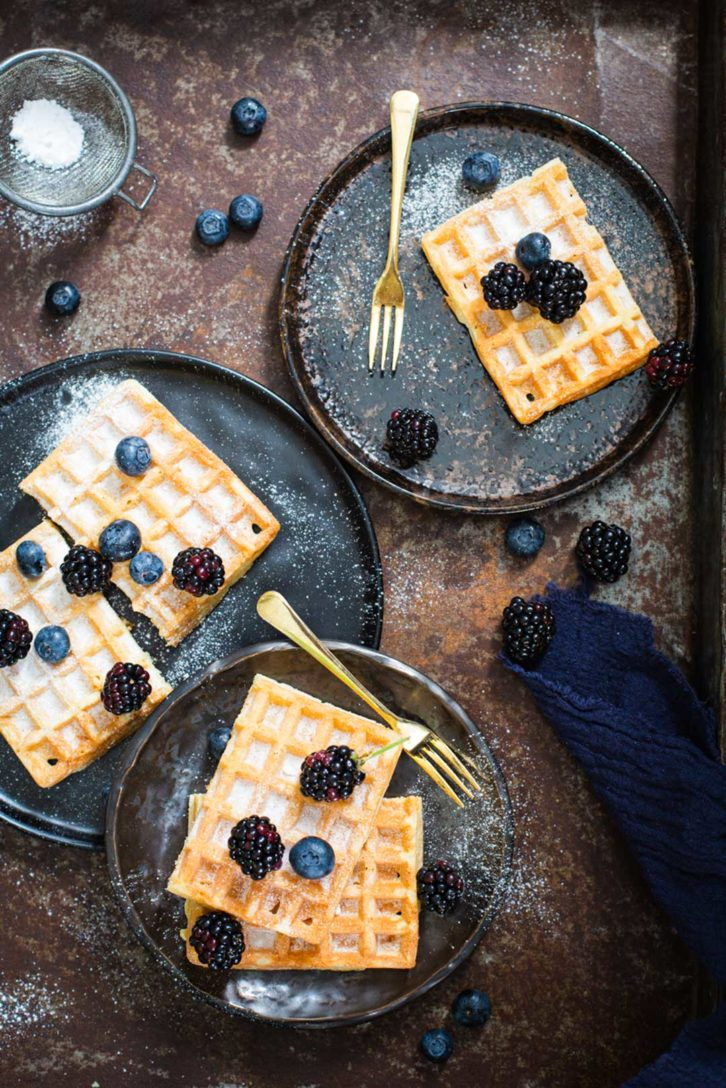 Blueberry waffles on plates
