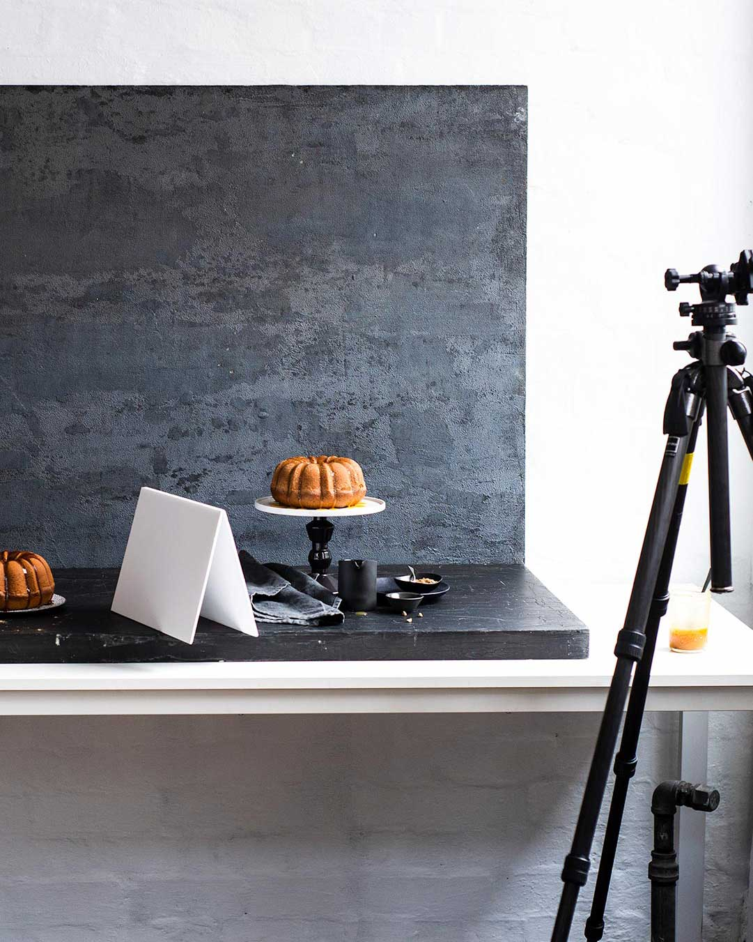 Behind the scenes shot of food photography with a tripod and bundt cake