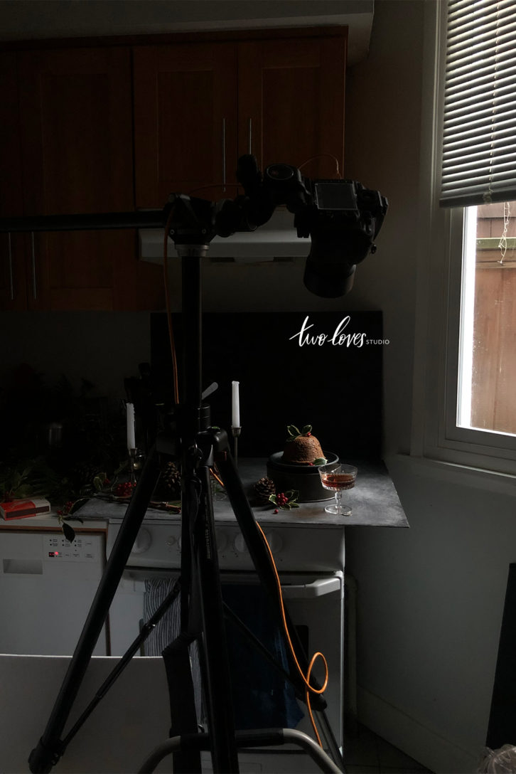 Low light food photography behind the scenes setup shooting a Christmas pudding.