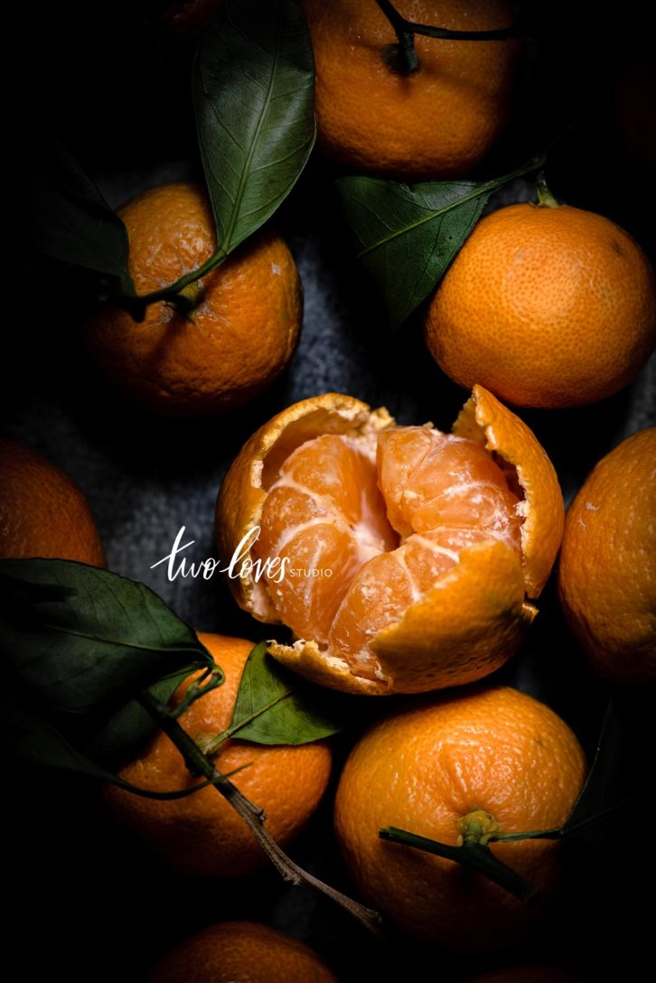 Clementines with leaves.