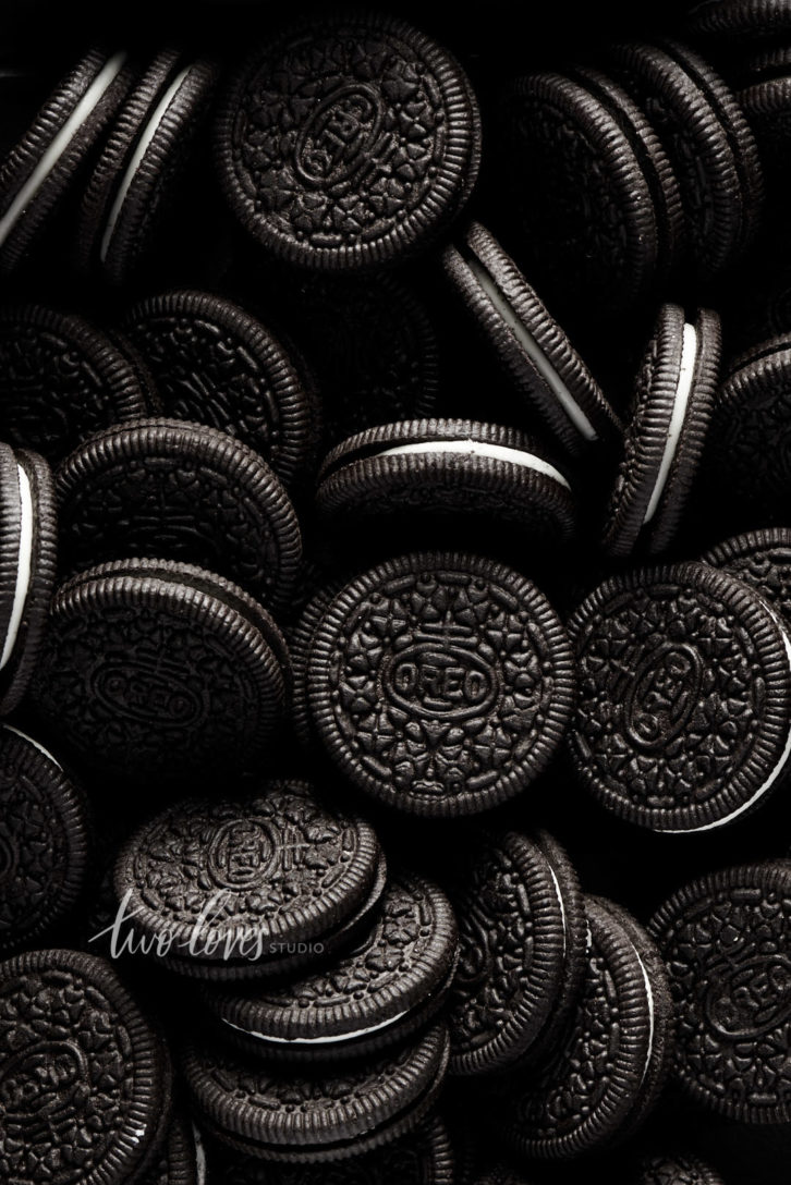 A dark shot of multiple oreo cookies.