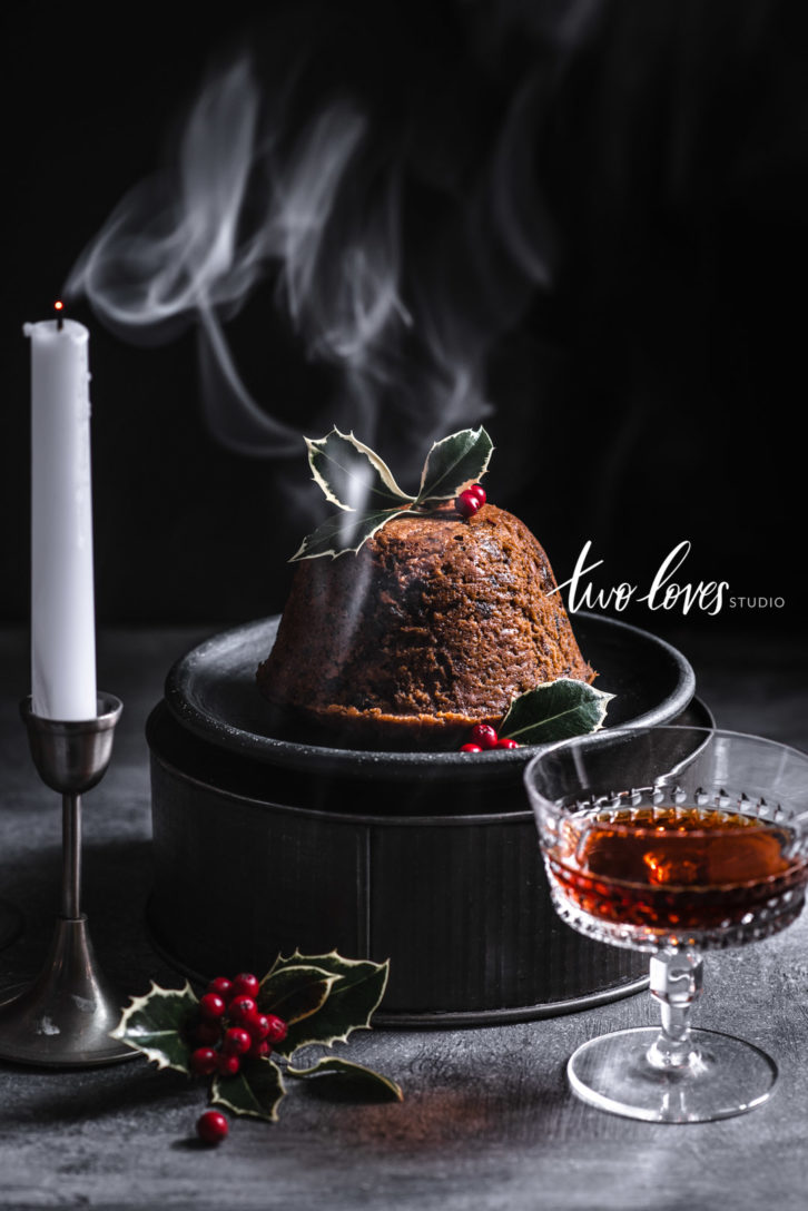 Christmas pudding with rum on a diy cake stand