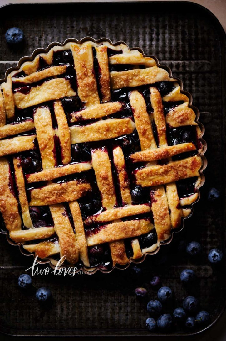 Blueberry pie lattice with juices flowing out.