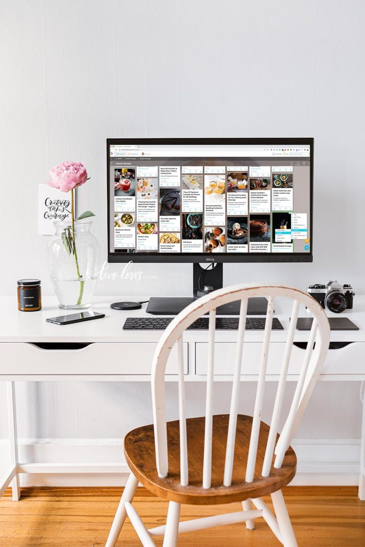 An office desk with chair and computer. The screen is showing how to create a mood board for photography clients.