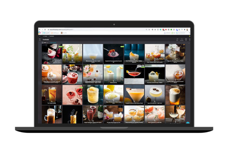 An iMac computer showing a series of cocktail images in a professional mood board using Bubllup.