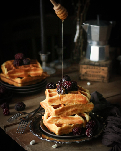 Waffles with Berries by Monique Polanco. Food photo shot with Canon EF Lens 50mm 1:18 STM. A blog post talking about favourite food photography lenses