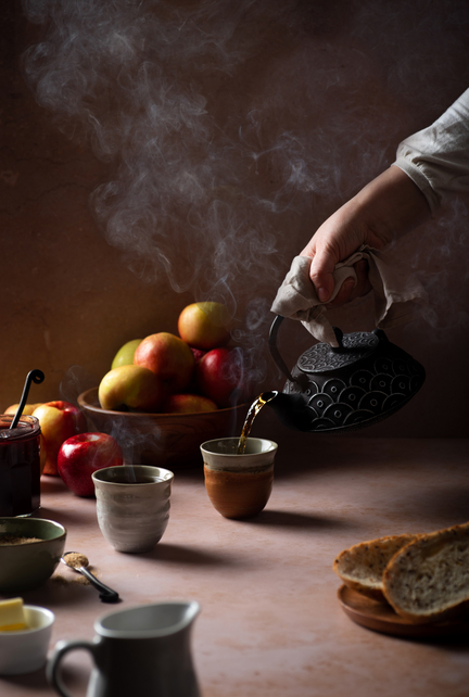Pouring Tea by Erin Beutel. Food photo shot with Promaster Spectrum 7 100mm 3.5.