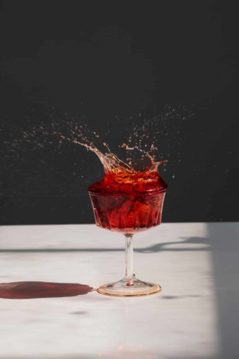 Red drink splash by Justin Sisson.  Food photo shot with Fujinon XF 56mm F/1.2