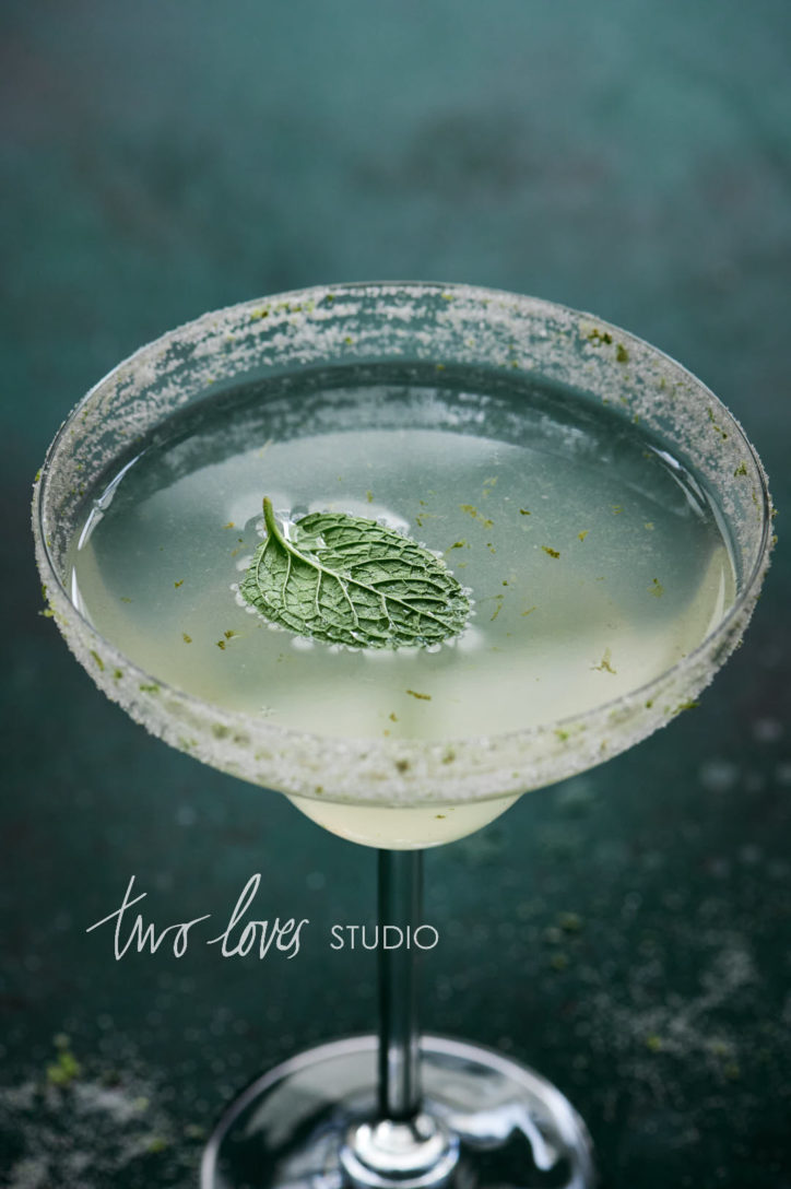 A macro shot of a cucumber margarita with a mint leaf. Shot with the 105mm macro. An article about which lens for food photography.