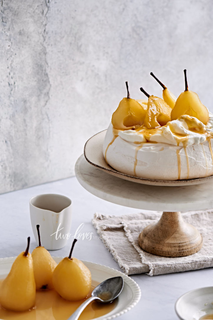 Meringue with poached pears ontop.  lens professional food photographer