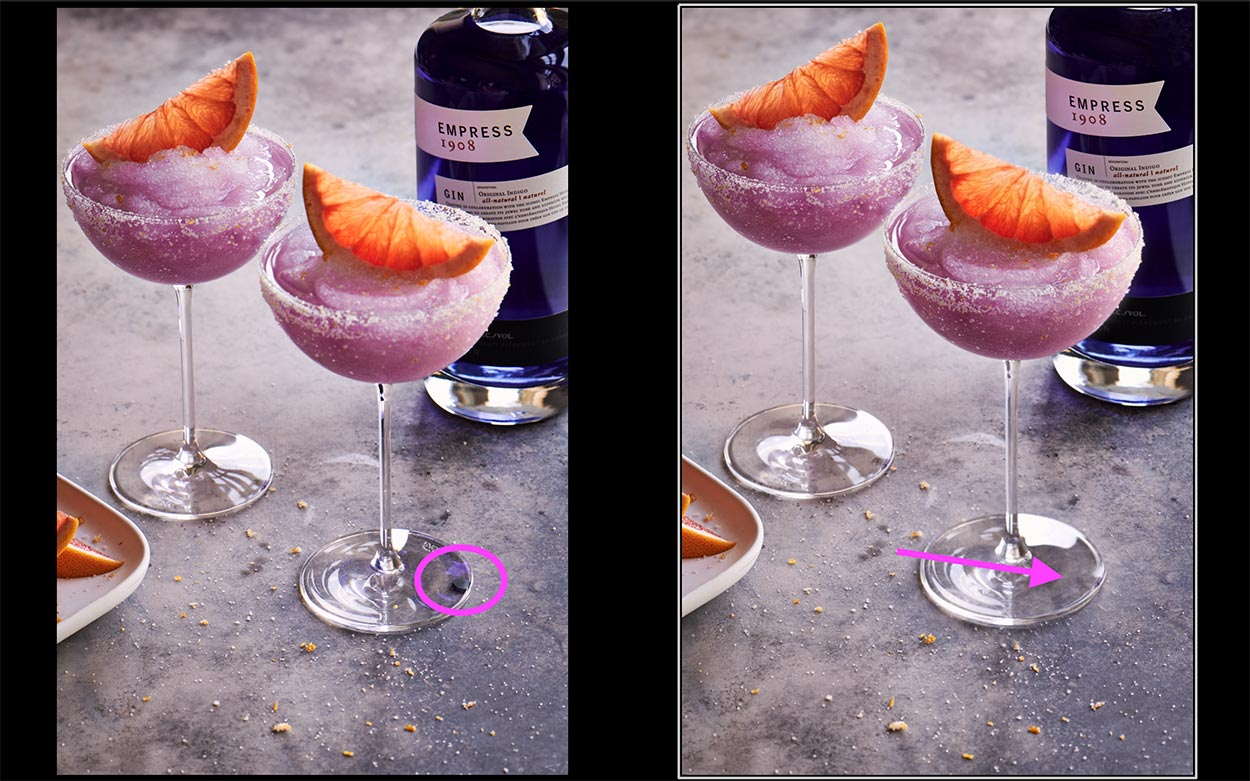 Drink photography of two frozen purple empress cocktails with an orange slice on top on a pale backdrop.