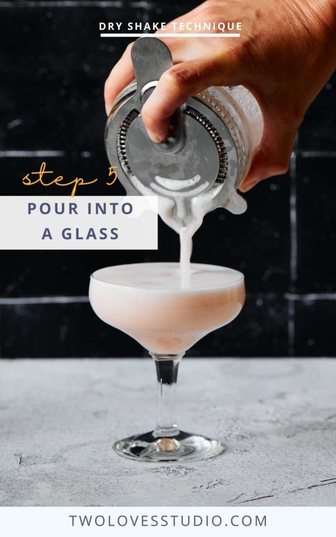 Step by step example. Cocktail liquid being poured from a mason jar on a dark background through a hawthorn strainer.