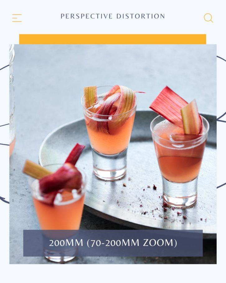 Drink photography example of three shot glasses on a grey background with rhubarb garnishes, in focus.