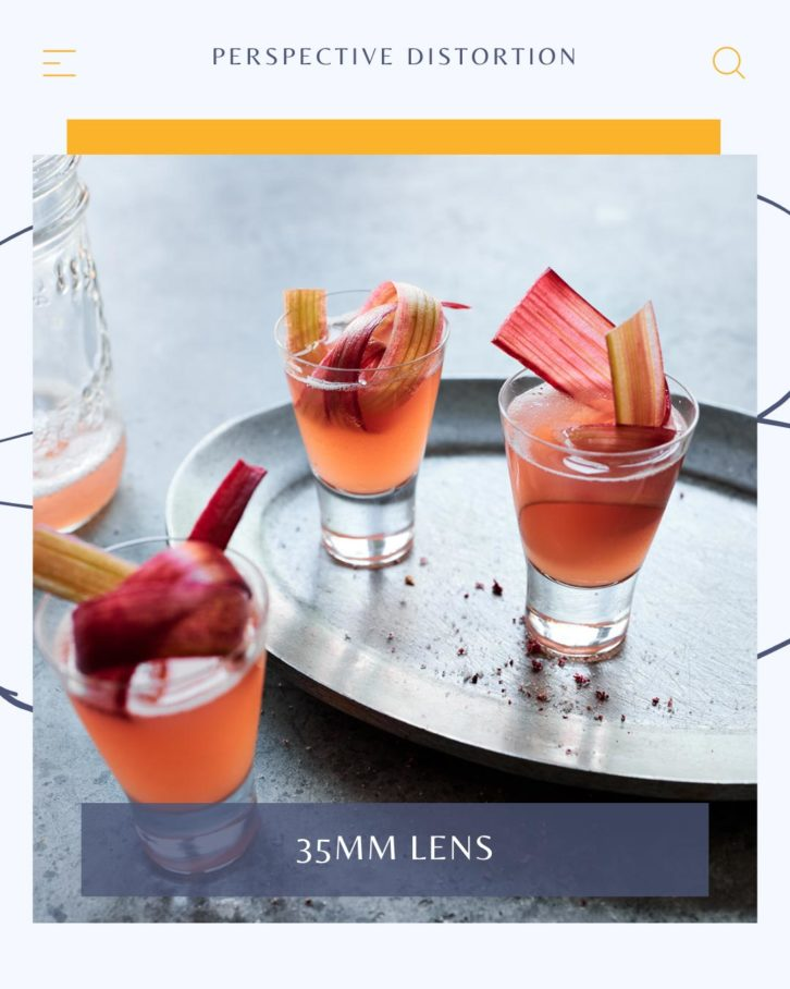 Drink photography example of three shot glasses on a grey background with rhubarb garnishes, distorted by a 35mm lens.
