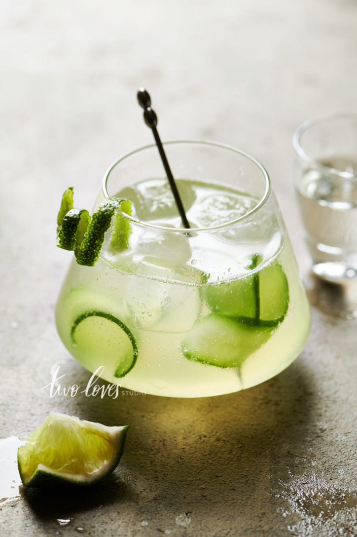 Cucumber and lime cocktail with a single lime swirl garnish.