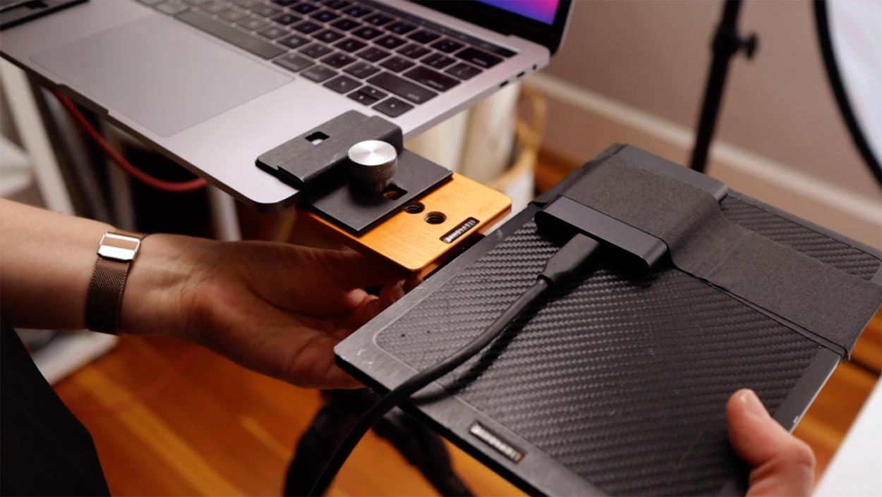 Behind the scene shot of a photography backup workflow. Tethering to an SSD drive during a photoshoot.
